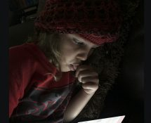 Scarlett by the Light of Her IPad